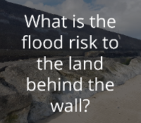What is the flood risk to the land behind the wall?