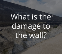 What is the damage to the wall?