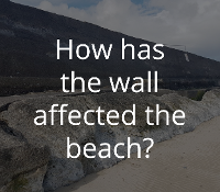 How has the wall affected the beach?